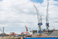 Dry docks and cranes in shipyard Royalty Free Stock Photography