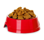 Dry dog food in bowl isolated Royalty Free Stock Photography