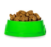 Dry dog food in bowl isolated Royalty Free Stock Images