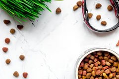 Dry dog food in bowl on stone background top view Royalty Free Stock Photos