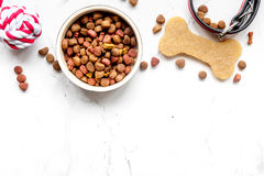 Dry dog food in bowl on stone background top view Stock Image