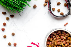 Dry dog food in bowl on stone background top view Royalty Free Stock Photo