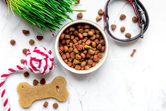 Dry dog food in bowl on stone background top view Stock Photography