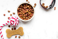 Dry dog food in bowl on stone background top view Stock Photos