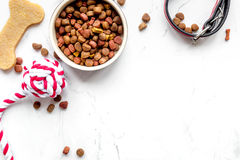 Dry dog food in bowl on stone background top view Royalty Free Stock Image