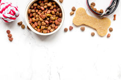 Dry dog food in bowl on stone background top view Stock Images