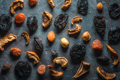 Dry dried apricots, figs and pears on a gray stone Royalty Free Stock Photos