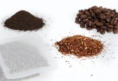 Dry drinks. Coffee beans, ceylon tea, green rooibos tea and bagged rooibs tea on white background Stock Image