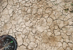 Dry earth and a compass Stock Photo