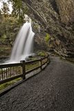 Dry Falls Waterfall. Dry Falls is a scenic 65 foot waterfall close to Highlands North Carolina. As you can see from the photo you can walk behind the waterfall stock photo