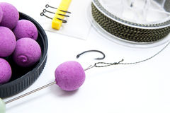 Dry feed for carp fishing. Carp boilies and accessories for carp Stock Photos