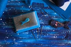 Dry Felting on brush with needles, handwork. Dry Felting on the brush with needles in the nautical theme, blue background, the concept of needlework and handwork royalty free stock photos
