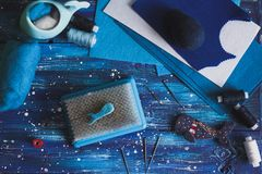 Dry Felting on brush with needles, handwork. Dry Felting on the brush with needles in the nautical theme, blue background, the concept of needlework and handwork stock images