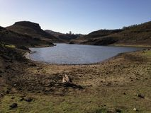 Dry field and lake in Gran Canaria. Dry field in the dam of las niñas, Gran Canaria, Canary islands, Spain stock photo