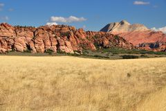 Dry field and red rocks Royalty Free Stock Images