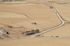 Dry field in Spanish village, dry grass, yellow, roads. Dry field in Spanish village, landscape in autumn, dry grass and roads from the top stock photography