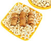 Dry figs and Cashews. Dry figs and cashew nuts in a ceramic plate on a white background Royalty Free Stock Photo