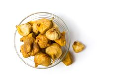 Dry figs in a glass bowl. Healthy snack Stock Images