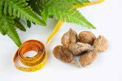 Dry figs. Measure tape and green leaves on white background Royalty Free Stock Image
