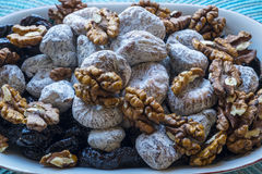 Dry figs prunes and walnuts in landscape close-up Stock Photos