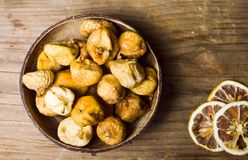 Dry figs in a rustic bowl tabletop shot Stock Image