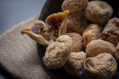 Dry figs in rustic wooden bowl dry fruits. Close up food still life Stock Image