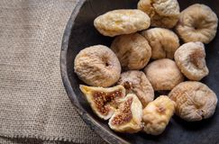 Dry figs in rustic wooden bowl dry fruits. Close up food still life Royalty Free Stock Image