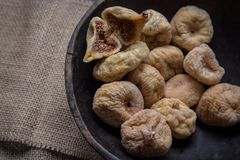 Dry figs in rustic wooden bowl dry fruits. Close up food still life Royalty Free Stock Photo