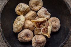 Dry figs in rustic wooden bowl dry fruits. Close up food still life Stock Images