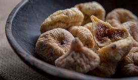 Dry figs in rustic wooden bowl dry fruits. Close up food still life Stock Photos