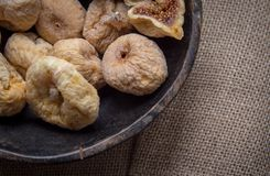 Dry figs in rustic wooden bowl dry fruits. Close up food still life Stock Photo
