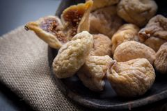 Dry figs in rustic wooden bowl dry fruits. Close up food still life Stock Photography