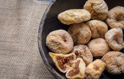 Dry figs in rustic wooden bowl dry fruits. Close up food still life Royalty Free Stock Images