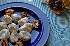 Dry figs and walnuts on a blue plate in landscape crop Royalty Free Stock Photography