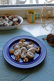 Dry figs and walnuts on a blue plate in portrait wide Stock Image