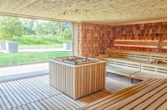 Dry Finnish sauna with double oven and large panoramic window. Dry Finnish sauna with large panoramic window Stock Photos