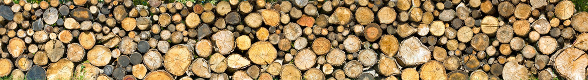 Dry firewood laid in a heap Royalty Free Stock Photos