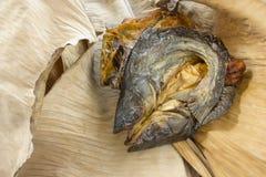 Dry fish on dry banana leaf Royalty Free Stock Photo