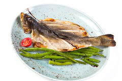 Dry fish on plate Stock Image