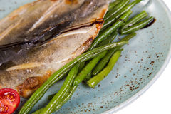 Dry fish on plate Royalty Free Stock Images