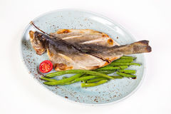 Dry fish on plate Royalty Free Stock Photography