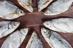 Dry fish on wooden background. Royalty Free Stock Image