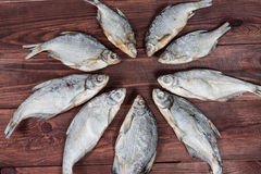 Dry fish on wooden background. Royalty Free Stock Images