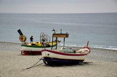 Dry fishing boats on the beach Stock Images