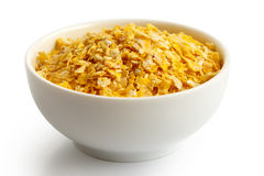 Dry flaked corn in white ceramic bowl. Dry flaked corn in white ceramic bowl  on white Stock Photography