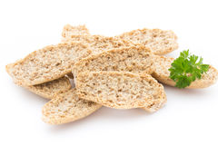 Dry flat bread crisps with herbs on a white background. Stock Photography