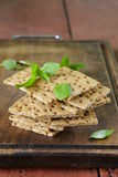Dry flat bread crisps with herbs Stock Image