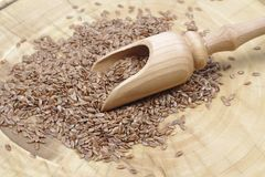 Dry flax seeds. With a wooden spoon Stock Photo