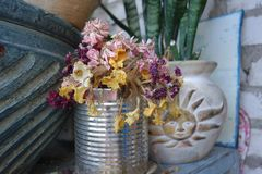 Dry flowers bouquet home design. A bouquet of dried flowers as a part of balcony interior design. Ceramic pot details royalty free stock images