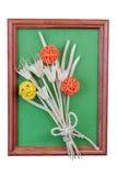 Dry flowers in a frame. Dry flowers in a frame isolated on white background Stock Photo